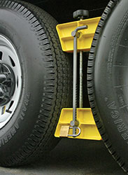 "Click for a larger picture of Trailer Aid Wheel Stop with Lock, 3.5"" to 5.5"" Wheel Spacing"